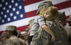 army serviceman holding daughter