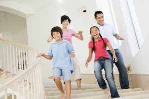 happy family running down stairs