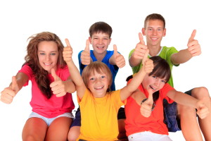 Teens and kids with thumbs up
